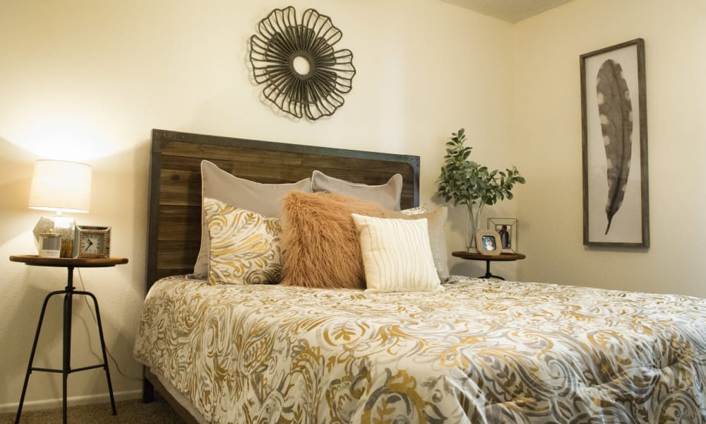 Nicely decorated bedroom at The Chimneys Apartments in El Paso, Texas