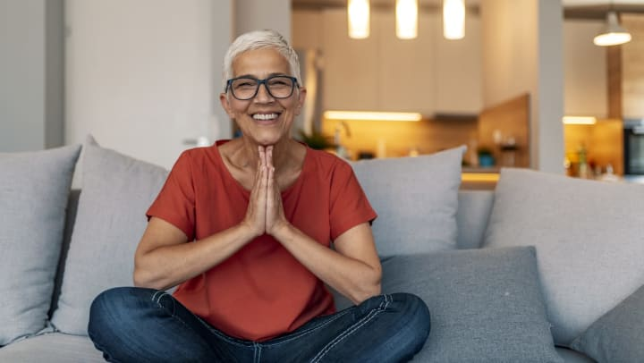Woman sitting on couch smiling