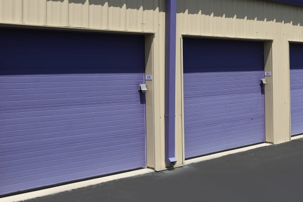 Exterior of some of our storage units with purple doors at Midgard Self Storage in Jacksonville, Florida