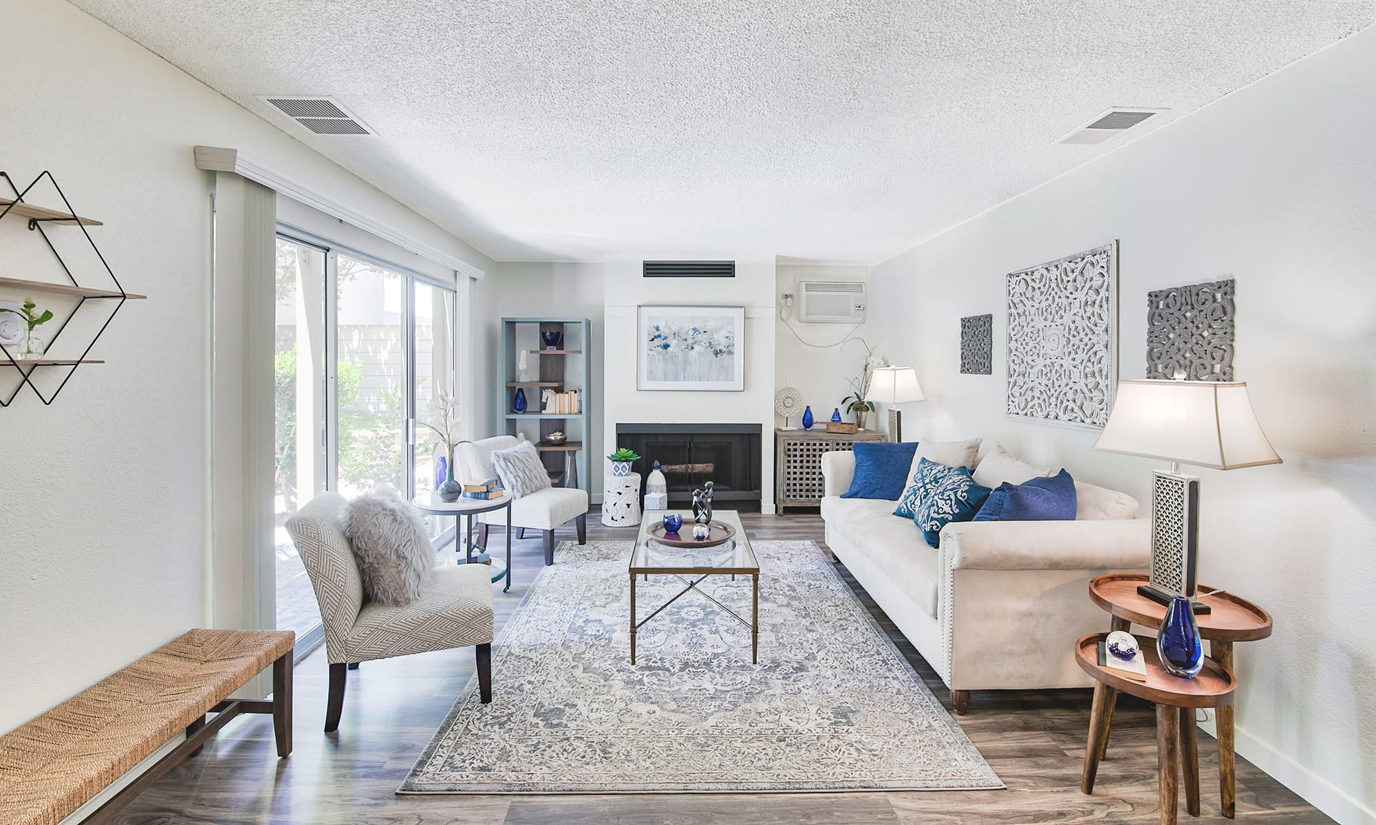 Bright and spacious open-concept living area in a model apartment at Mediterranean Village Apartments in Costa Mesa, California