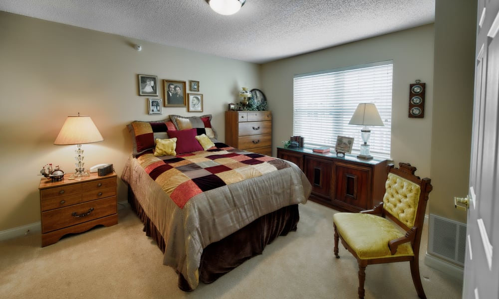 A cozy bedroom at The Keystones of Cedar Rapids in Cedar Rapids, Iowa