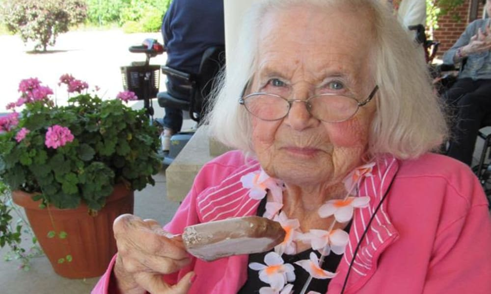 senior resident enjoying some ice cream