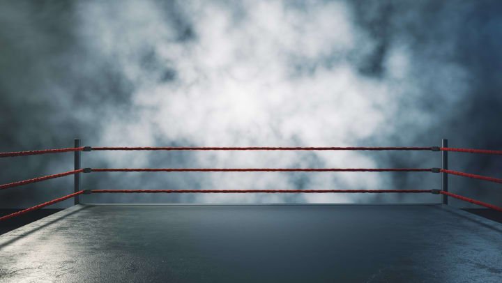 Wrestling/boxing ring surrounded by fog.