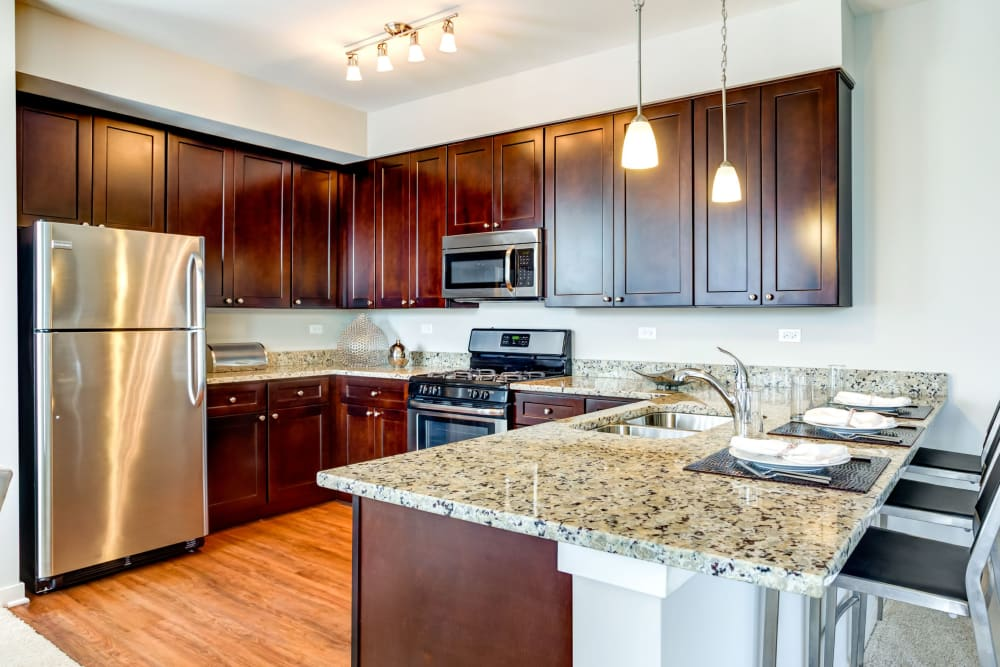 Kitchen with stainless steel appliances at The Oaks Of Vernon Hills in Vernon Hills, Illinois