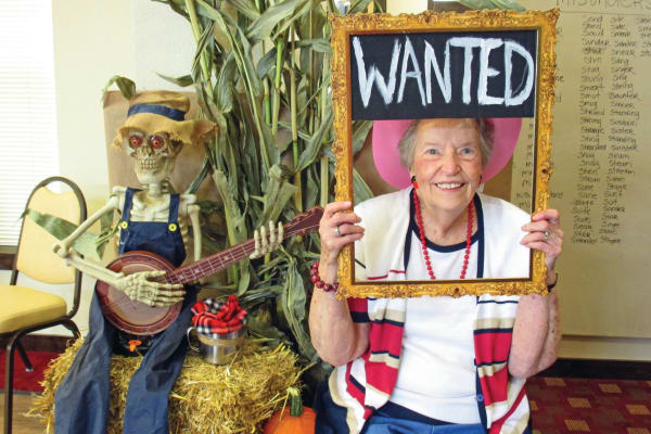 A resident with a wanted sign at Maple Ridge Gracious Retirement Living in Cedar Park, Texas