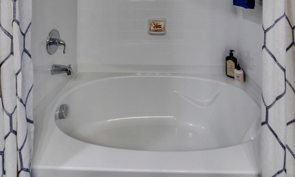 Shower bath combo in model bathroom at Bellrock Upper North in Haltom City, Texas