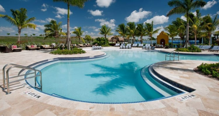 Swimming pool area on a beautiful day at Doral View Apartments in Miami, Florida
