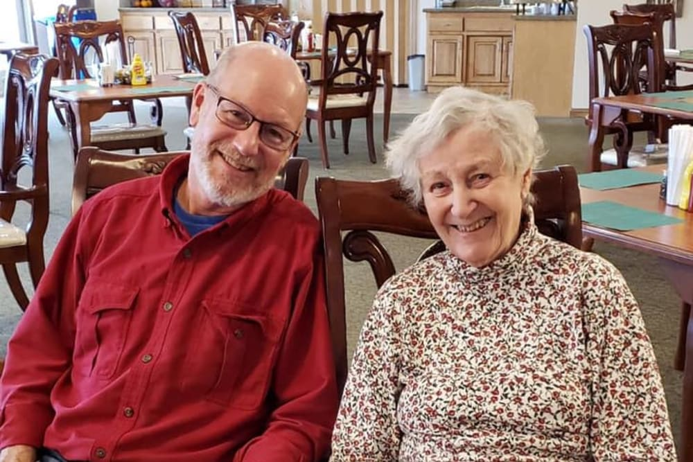 Residents smiling and sitting at Allouez Sunrise Village in Green Bay, Wisconsin