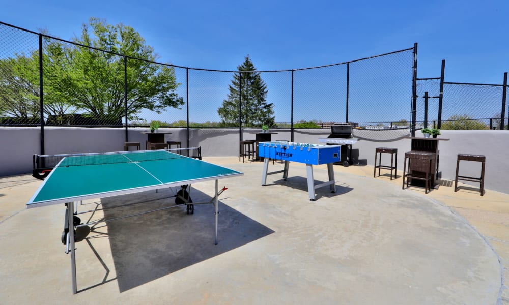 Pool side Grill and Games at The Colony at Towson Apartments & Townhomes