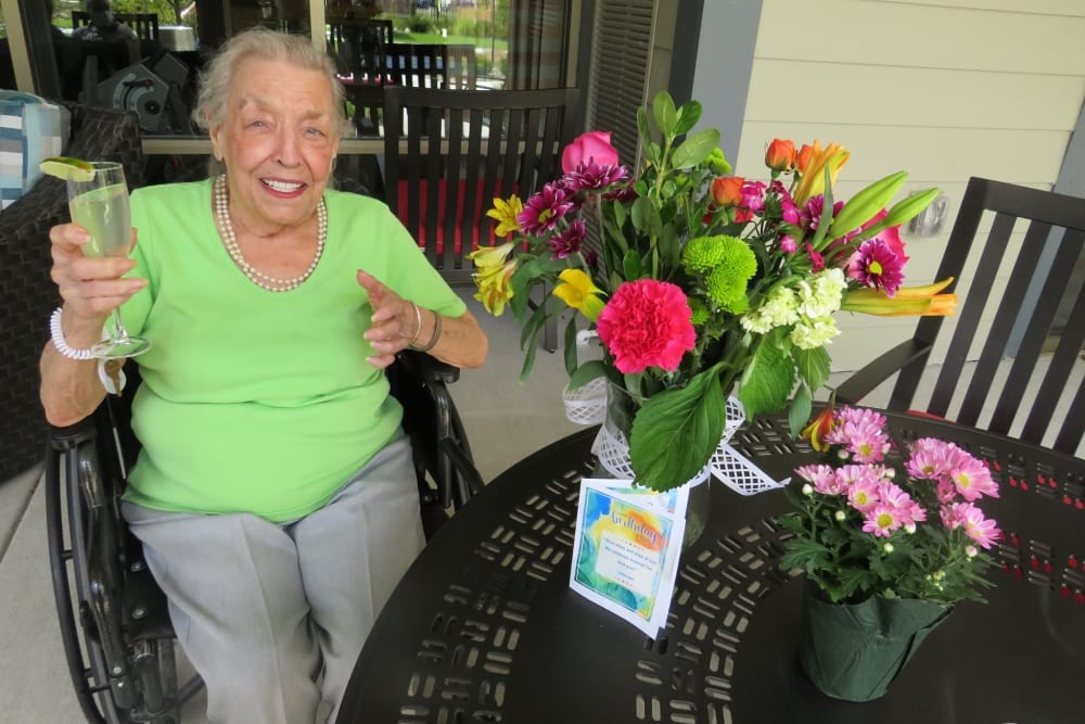 Resident receiving flowers at Aspired Living of La Grange in La Grange, Illinois