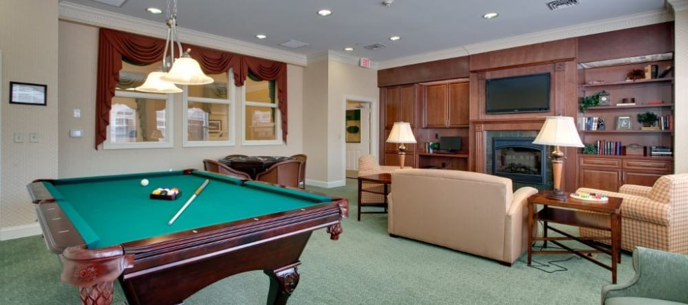 Game room with pool table at Waltonwood Cary Parkway
