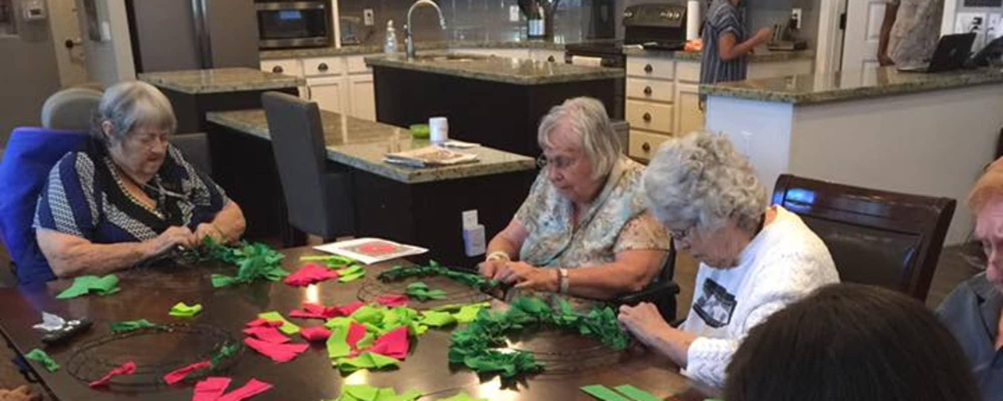 Seniors doing arts and crafts at Hacienda Del Rey in Litchfield Park, Arizona