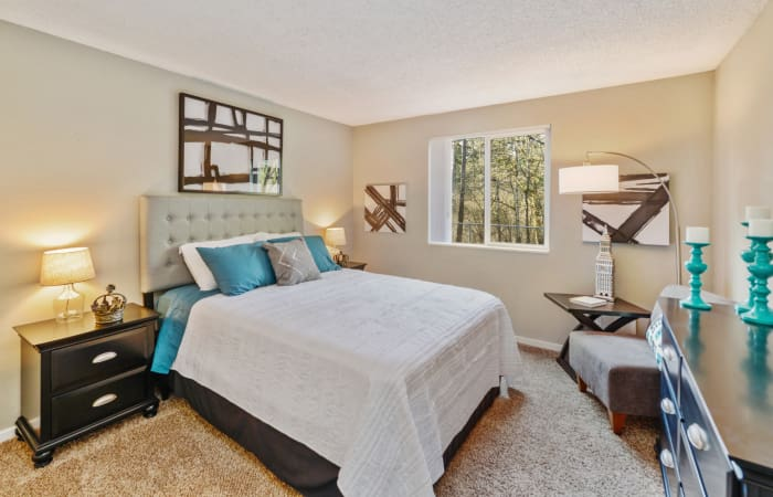 Large, well-decorated bedroom in model home at The Row