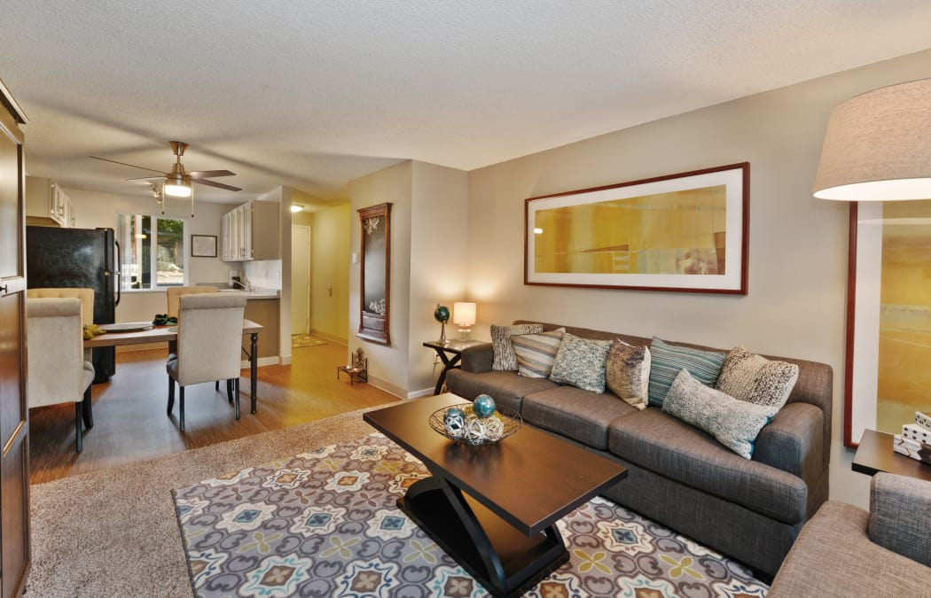 Well-decorated model home at The Row showcasing hardwood floors and ceiling fan
