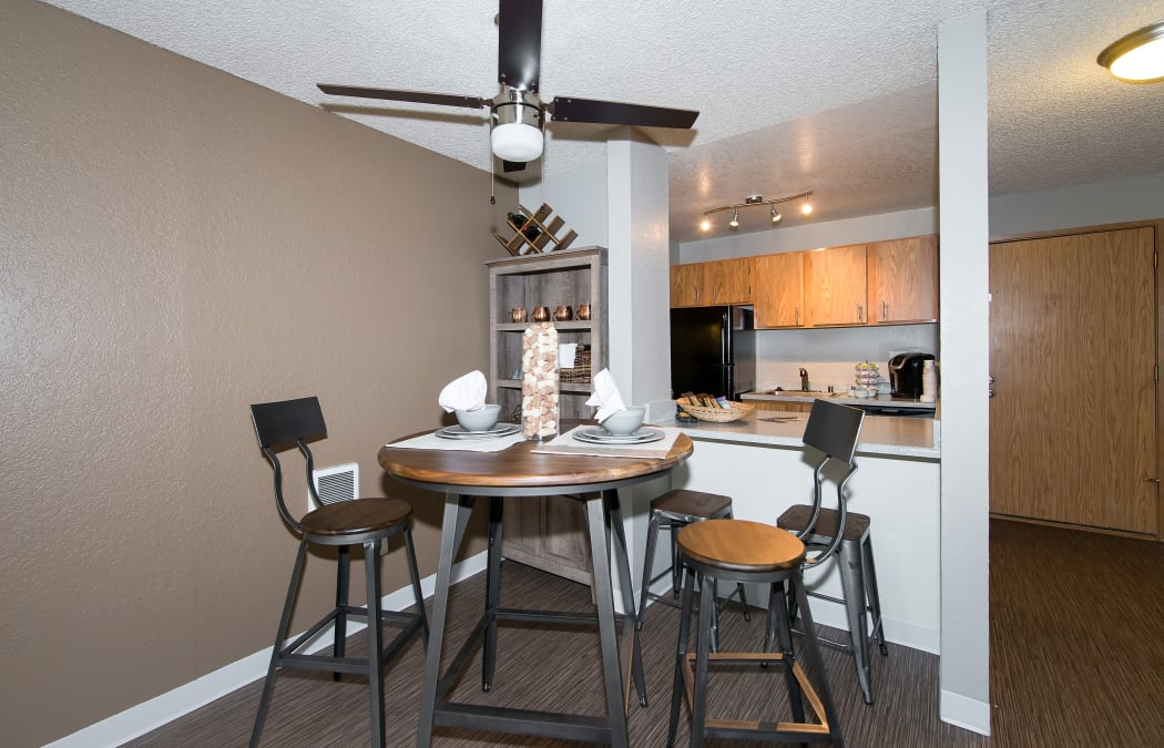 Dining area overlooking the kitchen's breakfast bar in model home at The Union
