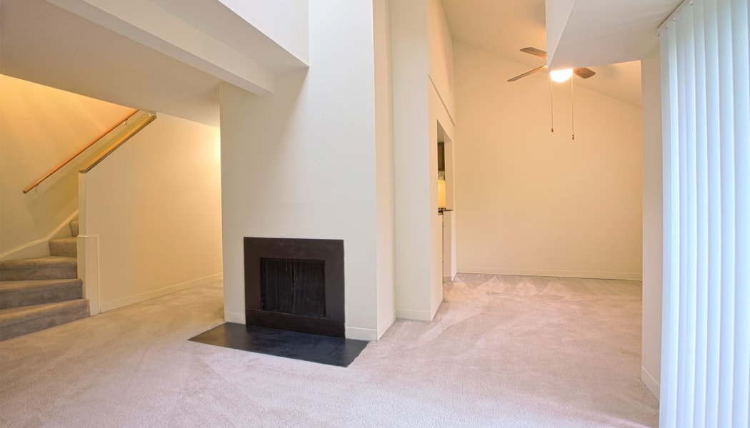 Fireplace and plush carpeting in a split-level home at The Chimneys of Cradlerock Apartments in Columbia, Maryland