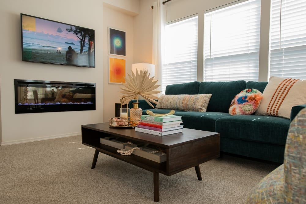 Living room with LED fireplace at Artisan Crossing in Norman, Oklahoma