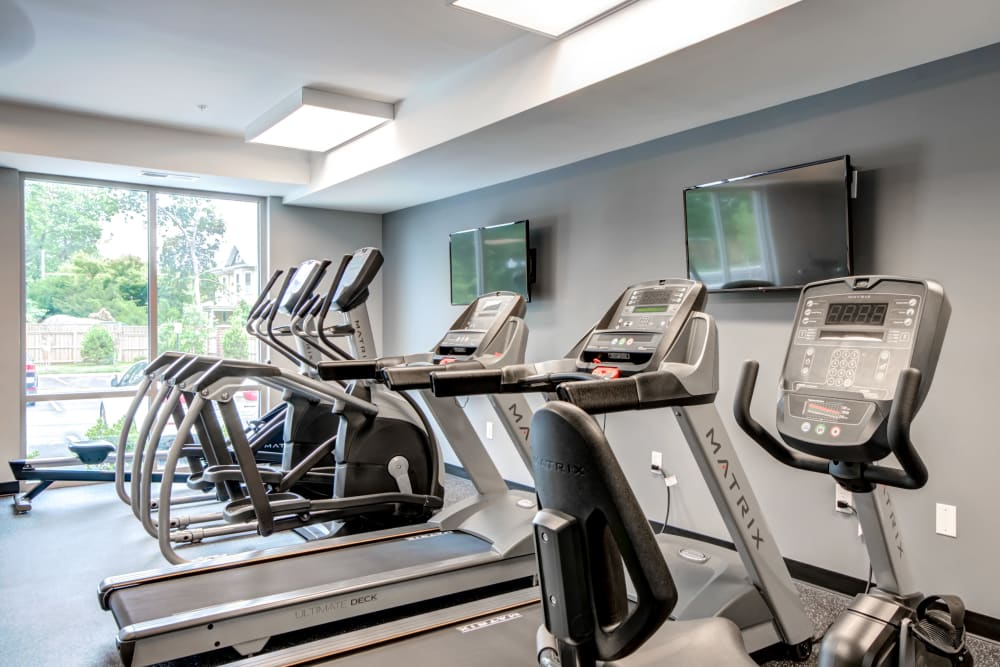 Resident gym with individual workout stations at Manassas Station Apartments in Manassas, Virginia