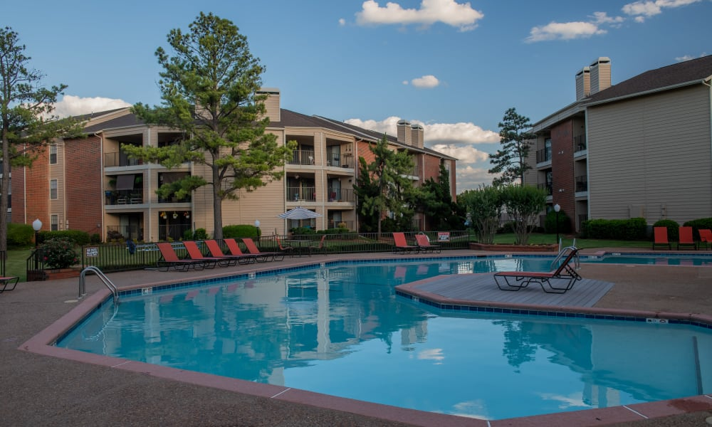 Relaxing pool with seating at Copperfield Apartments in Oklahoma City, Oklahoma