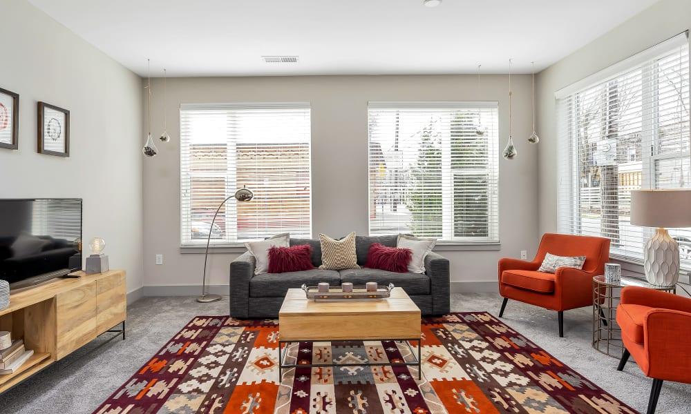 Carpeted living room at Gantry Apartments in Cincinnati, Ohio