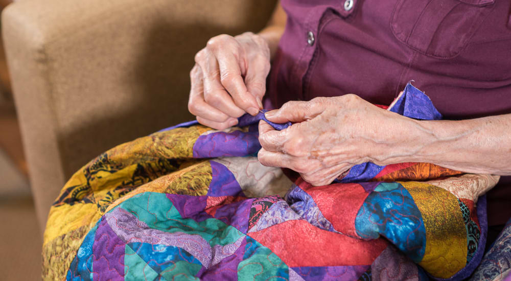 Resident quilting at The Springs at Tanasbourne in Hillsboro, Oregon