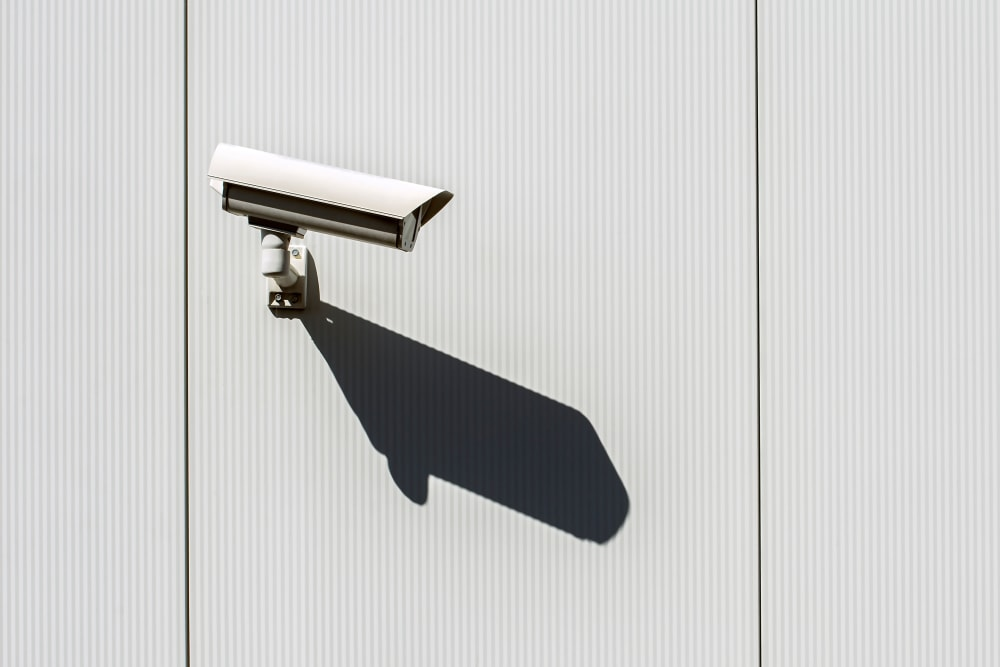 Security camera mounted to a wall at 603 Storage - Hudson in Hudson, New Hampshire