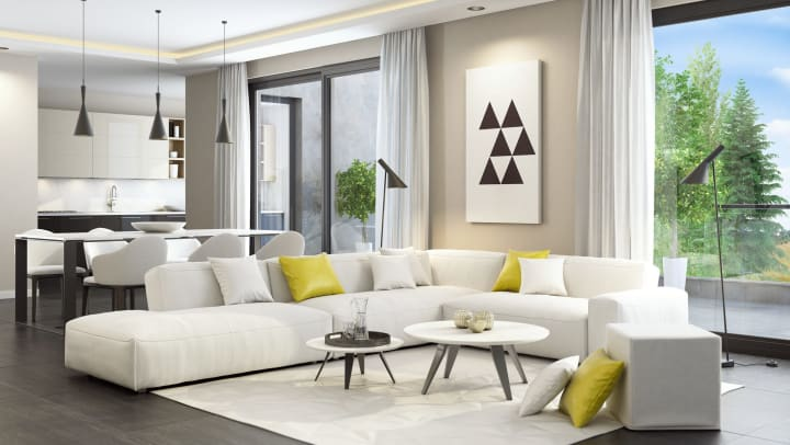 Fresh and modern white style living room interior with dining table and kitchen in the background.
