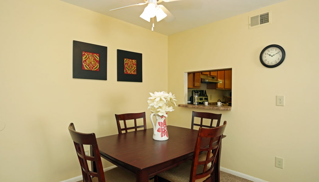 Dining area adjacent to kitchen in model home at Apex at Ashton Green in Newport News, VA