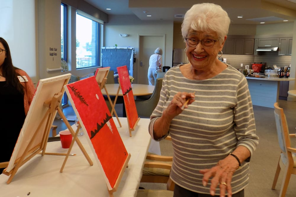Resident enjoying paint and sip event at Merrill Gardens at Rockridge