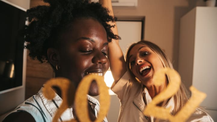 Two female friends celebrating the New Year
