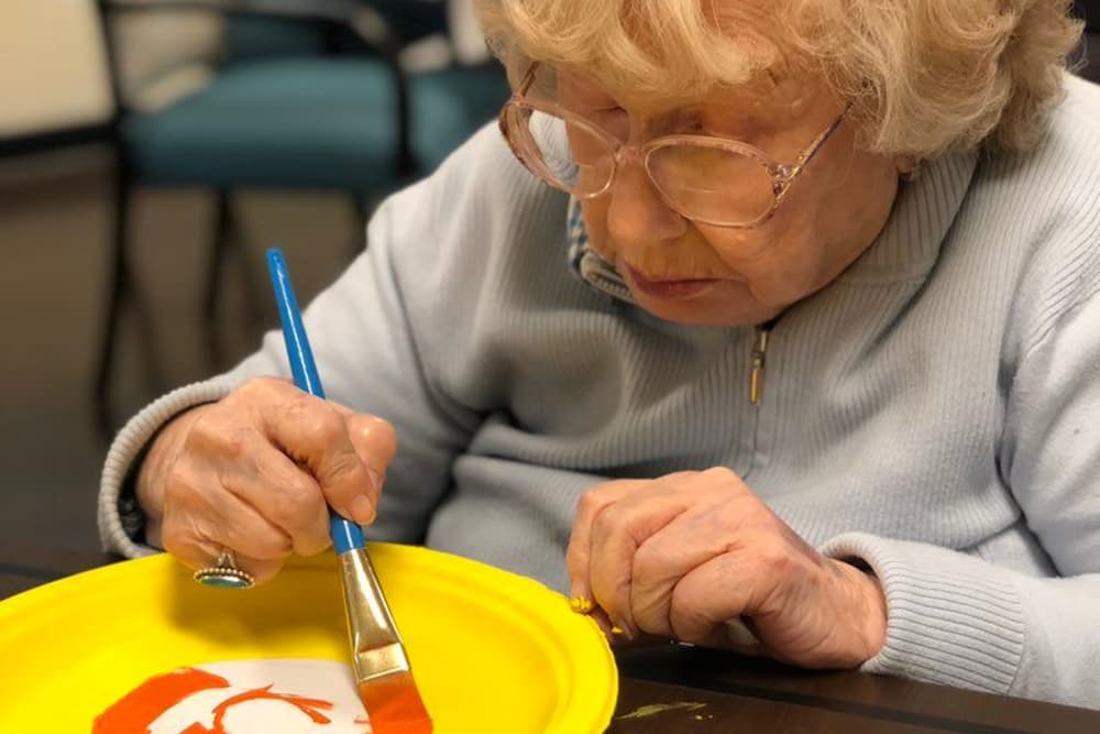 A resident painting at The Oaks at Woodfield in Grand Blanc, Michigan