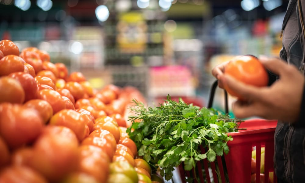 Resident shopping for fresh produce at a local market near Waters Edge at Marina Harbor in Marina Del Rey, California