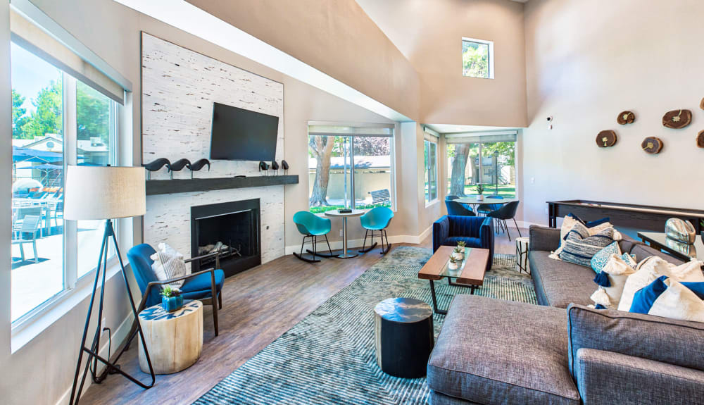 Beautifully designed lounge area in front of the fireplace in the clubhouse at Mountain Vista in Victorville, California