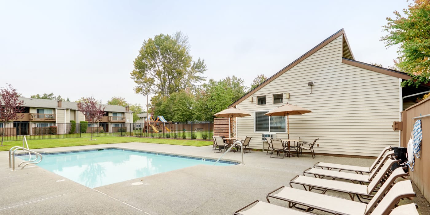 Beautiful swimming pool area at Arbor Chase Apartment Homes in Kent, WA