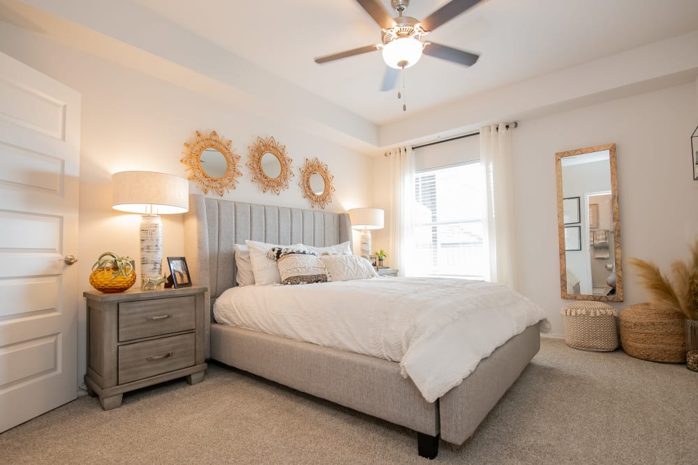 Bedroom with bright light at Artisan Crossing in Norman, lOklahoma
