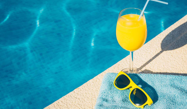 A drink and sunglasses by the pool at Park Trail Apartments in Shelbyville, Tennessee