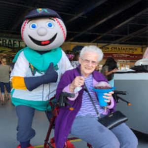 Resident Bev at a local baseball game for her Dare to Dream event near Corridor Crossing Place in Cedar Rapids, Iowa.