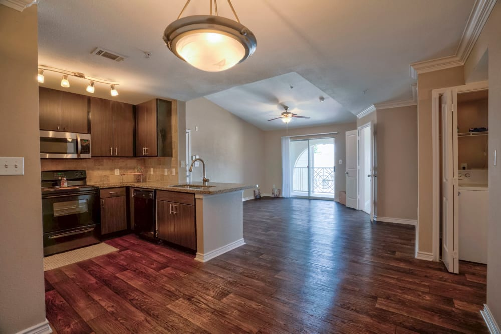 living space in an open-concept model home at Southwind at Silverlake Apartments in Pearland, Texas