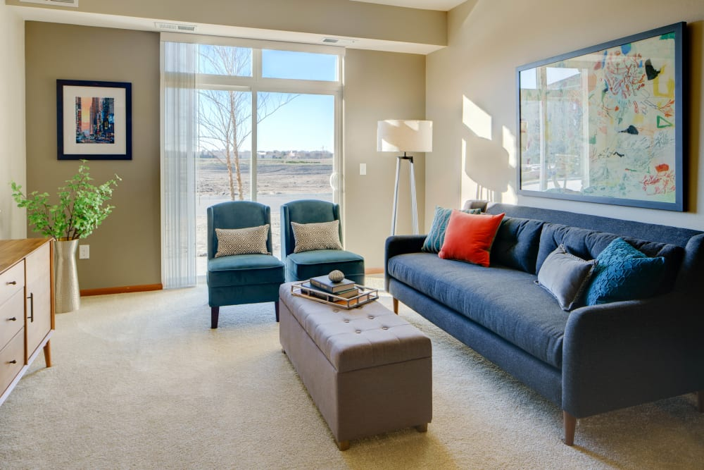 Beautiful living room with lots of natural lighting at Remington Cove Apartments in Apple Valley, Minnesota