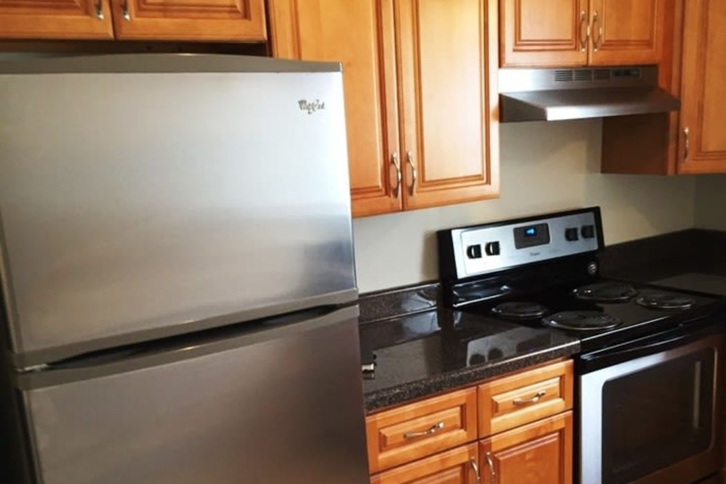 Stainless-steel refrigerator and cooking range at Orchard Hills Apartments in Whitehall, Pennsylvania