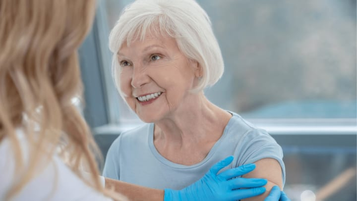 Grandma getting vaccinated