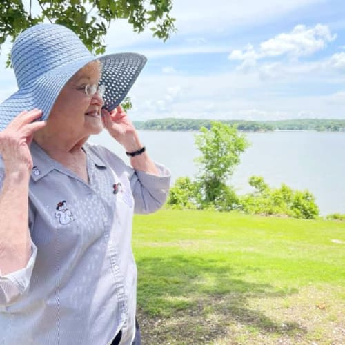A resident in a hat outside at Oxford Glen Memory Care at Owasso in Owasso, Oklahoma