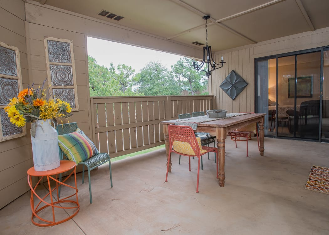 Covered outdoor patio at Woodscape Apartments in Oklahoma City, Oklahoma