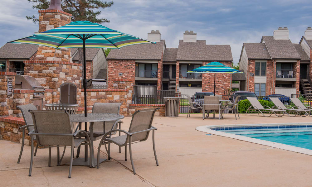 Poolside seating at Warrington Apartments in Oklahoma City, Oklahoma