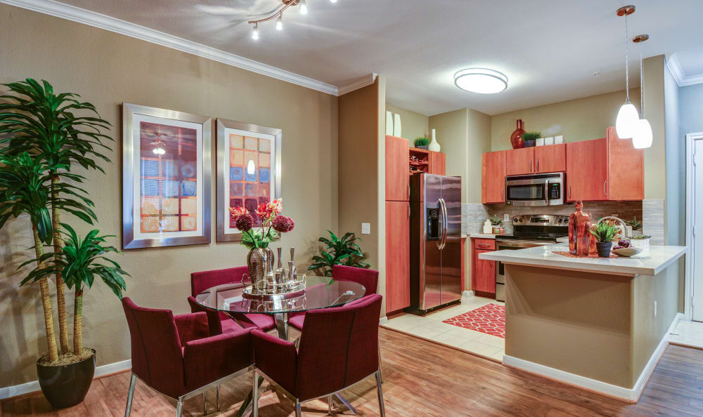 Dining area looking into gourmet kitchen of model home at San Paloma Apartments in Houston, Texas