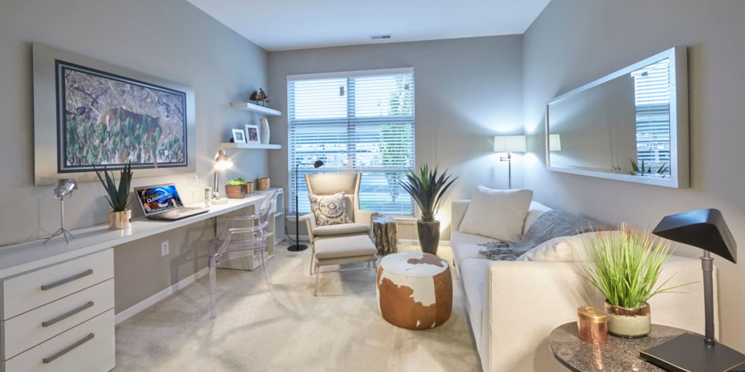 Beautifully decorated living area in a model home at Uptown Ann Arbor in Ann Arbor, Michigan