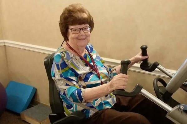 resident on nustep trainer as part of her therapy