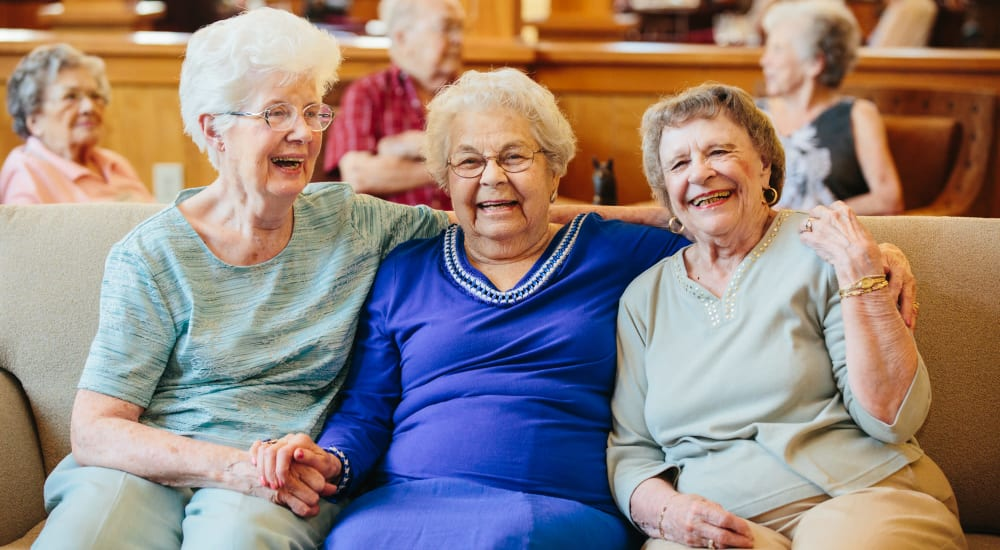 Three residents enjoying the comfortable lounge at The Springs at Missoula in Missoula, Montana