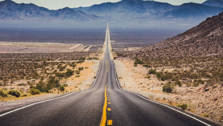 Endless straight road in the American southwest region