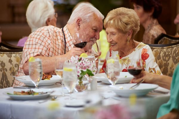 Resident couple share a special moment in the dining room at The Crossings at Eastchase in Montgomery, Alabama